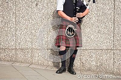 Bagpiper dressed in kilt