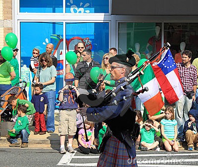 Bagpiper with Flags Editorial Photo
