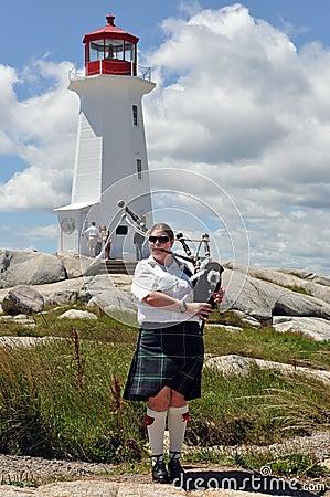 Bagpiper at Peggy s Cove, Nova Scotia Editorial Photo