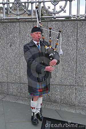 Bagpiper,Princess Street,Edinburg,Scotland Editorial Image
