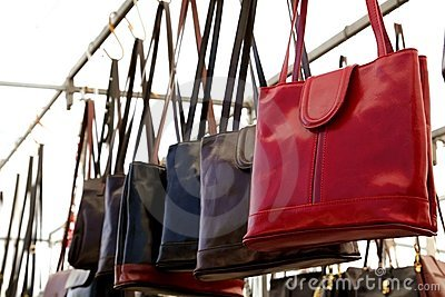 Bags rows in retail shop handbags leather red