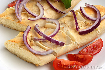 Baguette as snack with onion and tomato