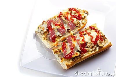 Baguette brindado do queijo e da carne