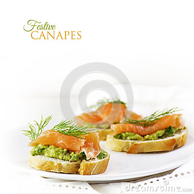 Free Baguette Slices With Smoked Salmon And Avocado Cream Or Guacamol Stock Photo - 83448960
