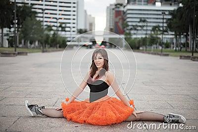 Bailarina que executa um split