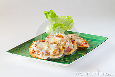 Bread topped with pork and cheese