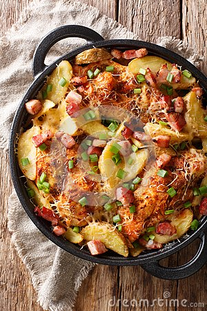 Free Baked Chicken Fillet With Potatoes, Bacon And Cheese Close-up In Royalty Free Stock Photos - 133607358
