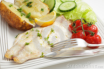 Baked fish fillet, tomatoes, potato and salad