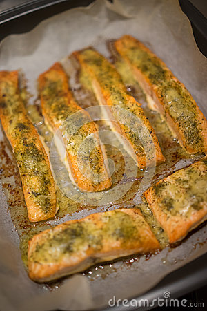 Baked fish fillets in an oven pan stock photo image for Fish fillet in oven