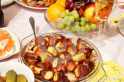 Baked potatoes in bacon