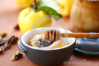 Baked quince with walnuts and honey