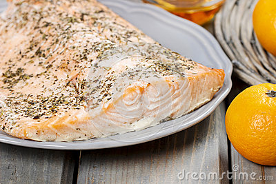 Baked salmon on grey plate
