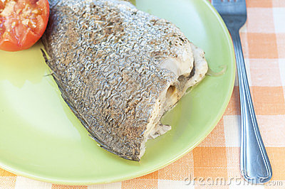 Baked seabass with tomatoes