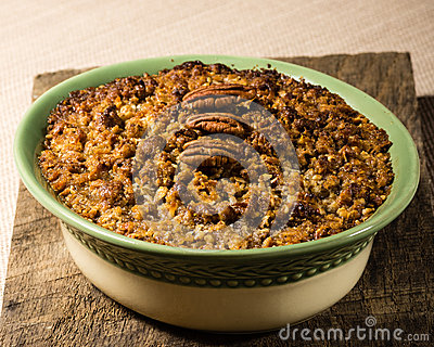 Baked sweet potato casserole with pecan topping