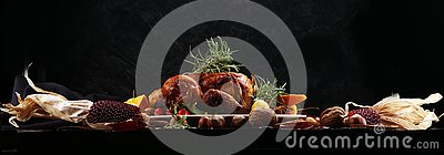 Baked turkey or chicken. The Christmas table is served with a turkey, decorated with fruits, salad and nuts. Fried chicken, table Stock Photo