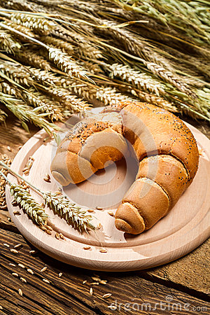 Baked twirl surrounded by grains with ears