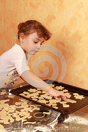 Baker child baking cookies