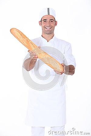 Baker displaying bread