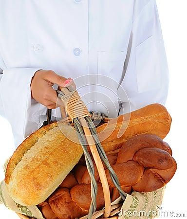 Baker Holding a Basket of Bread