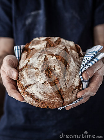 Free Baker Man Holding Rustic Loaf Of Bread In Hands Royalty Free Stock Photography - 37473007