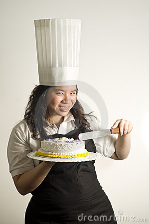 Baker teasing and preparing to cut a cake
