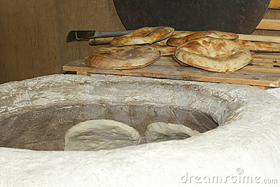 Baking pita bread in a stone oven