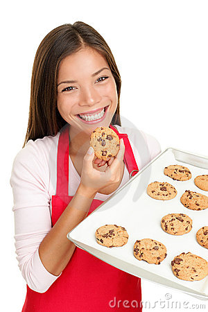 Free Baking Woman Eating Cookies Happy Stock Photos - 21071263