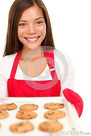 Baking woman showing cookies