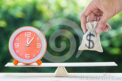 Balance time and money savings investment concept Stock Photo