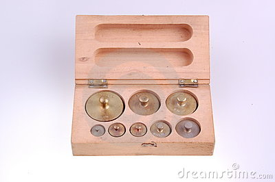 Balance weights in wooden box