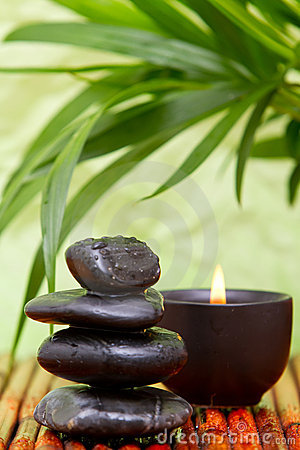 Balanced pebbles and aromatherapy candle