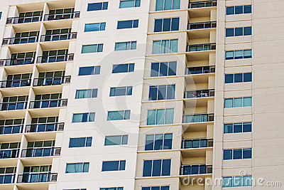 Balconies and Windows on Beige Condo Wall