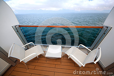 Balcony with chairs table on ship