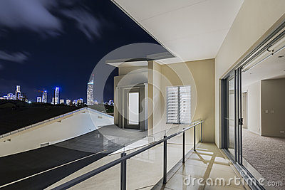 Balcony exterior of mansion with night views of skyline for Balcony overlooking city