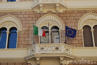 Balcony with flags of Italy and Europe