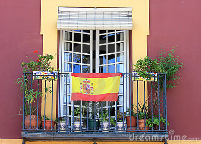 Balcony with spanish flag in seville spain royalty free for Balcony in spanish