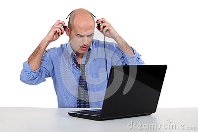 Bald businessman with laptop