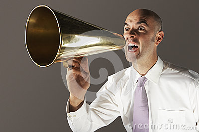 Bald Businessman Shouting Through Megaphone