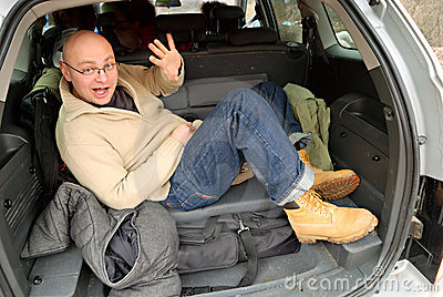 Bald man in car trunk