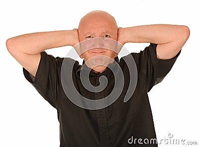 Bald man covering ears