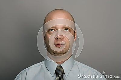 Bald man looks upwards