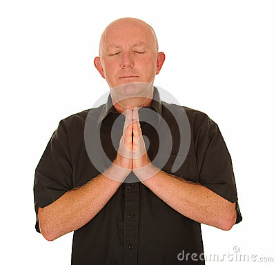 Bald man praying
