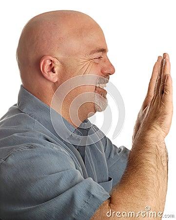 Bald man pushing something