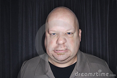 Bald man sneering.