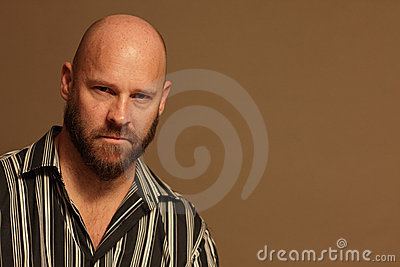 Bald man in a striped shirt