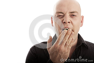 Bald man is tired and yawn