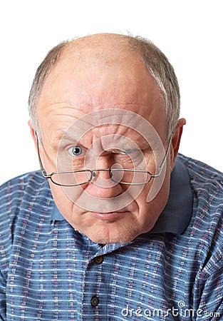 Bald senior man fooling around