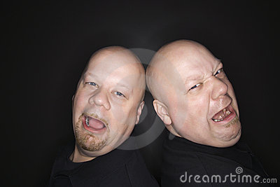 Bald twin men crying.