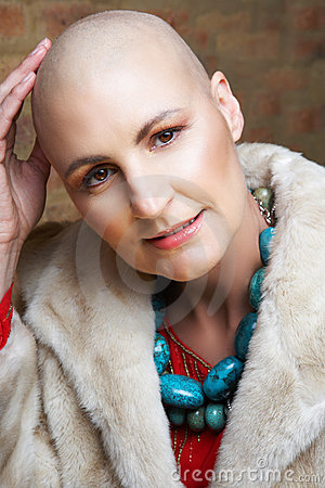 Bald woman in fur coat