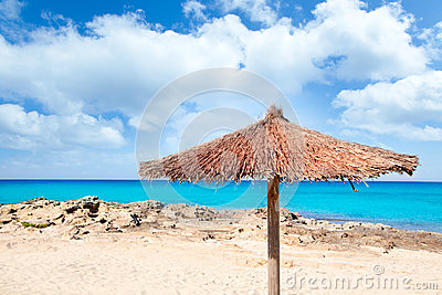 Balearic Formentera island with umbrella beach